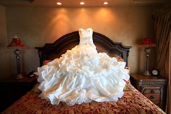 Ocean Lodge: Sarah's dress draped over the bed in the suite at Sarah & Brent enjoy their wedding at the Ocean
