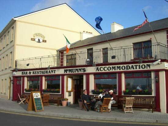 McMunn's of Ballybunion: Here is a picture of my friends and I have a pint outside McMunn's after a day of golf