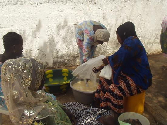 Gambia: Ladies cooking at naming ceremony Pipeline