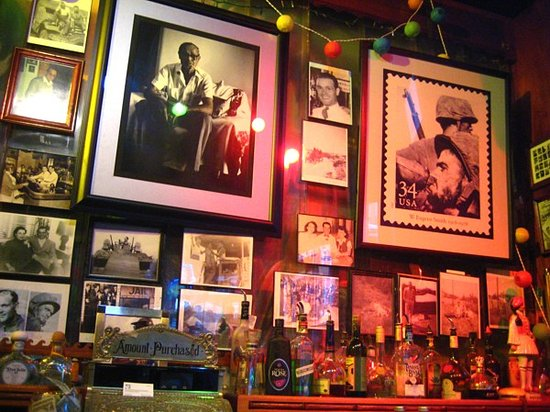 Evangelo's: Photos behind bar include owner's dad on U.S.stamp