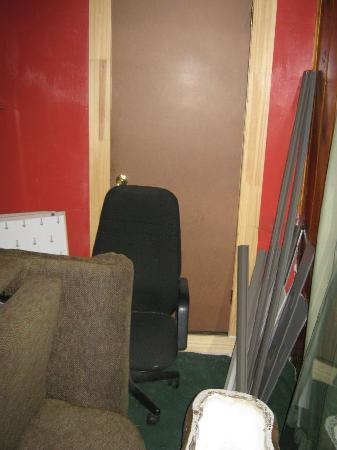 Shore Acres Lodge: #2 Bedroom door, junk particle board. Anyone could come in this way.