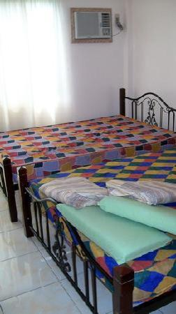 Dapitan/ Dipolog Monina Pension House: A double double room being made up