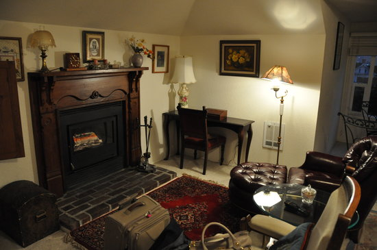 This Olde House Bed and Breakfast: The wood-burner and seating area.