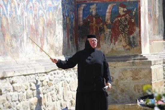Moldovita Monastery : Manastirea Moldovita - a nun during a guided tour