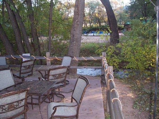 Amanda's Fonda: outside seating back by creek