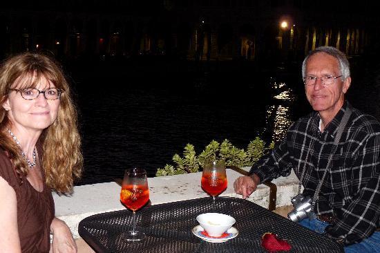 Al Ponte Antico Hotel: My favorite ritual of the trip: spritzes on the balcony