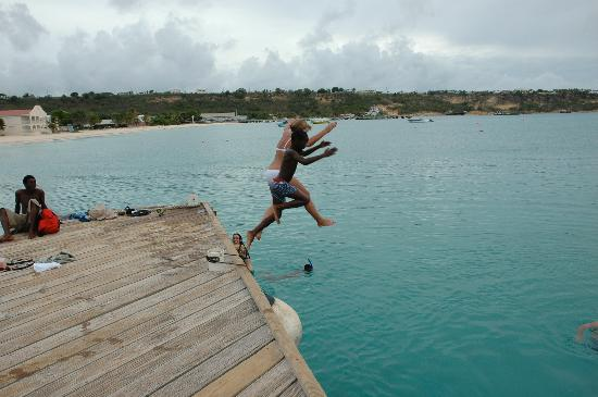 Pier jumping with local kids at Sandy Bottom (Cap Juluca snorkel trip)