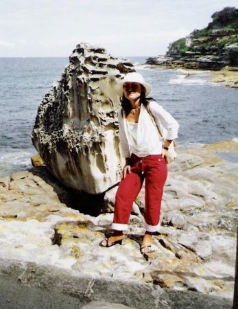 Bondi Beach: Christine next to an old boulder on a Sydney Beach