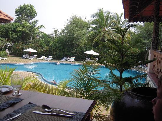 The Travancore Heritage Beach Resort: View of top restaurant and pool