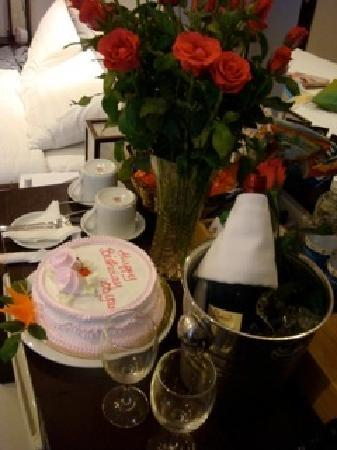 Now thats a birthday surprise Cake flowers and wine Plus a