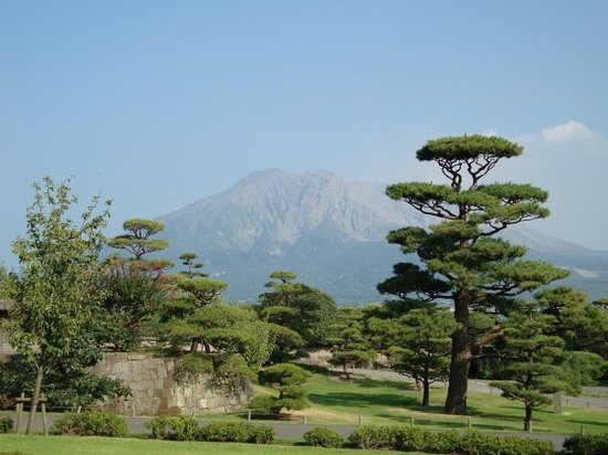 "Kagoshima, Japan: A nic example of a traditional Japanese garden using a technique called ""borrowed scenery"" - an"