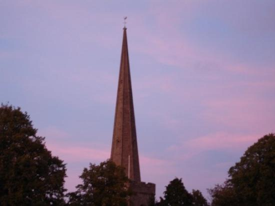 Sunset behind the spire of one of the Newent churches.