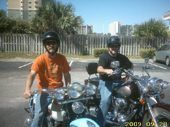 Top of the Gulf Suites: Randy & Timmy on Harley's in parking lot  at Top of the Gulf
