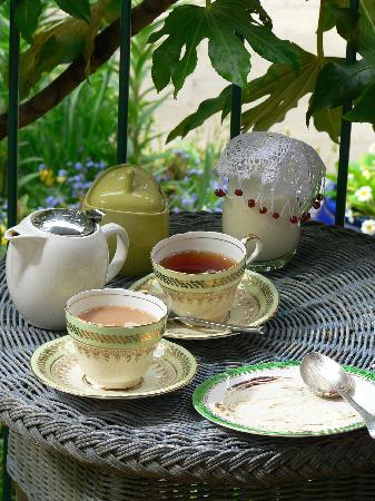 The Old Villa: Enjoying tea on our little porch overlooking the gardens...