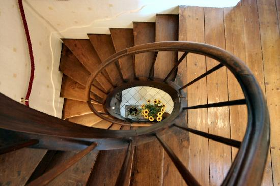 Enchantee: Spiral staircase leading to guest bedrooms