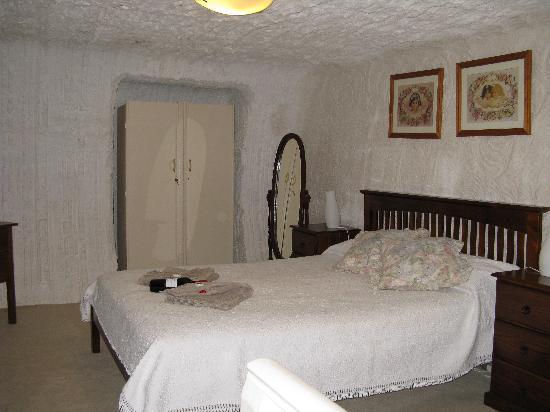 Underground Bed & Breakfast: Comfortable bedroom. And dark!