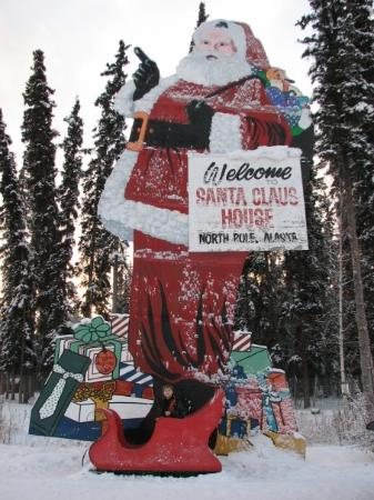 Santa Claus House: Rols poses in Santa's sleigh!