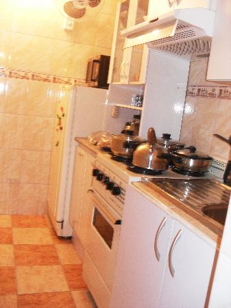 Machu Picchu Suites: The kitchen. Narrow but has everything you'll need to prepare your own food.