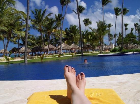 Iberostar Grand Hotel Bavaro : Sitting poolside, watching the hubby swim by.