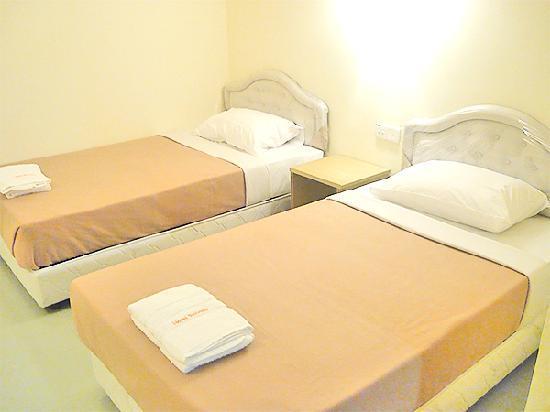 Kingdom Boutique Hotel : hotel reban deluxe  bed