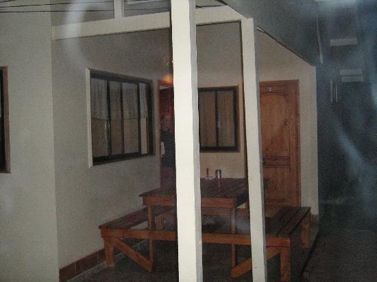 Picnic table at entrance to Chez Cecilia