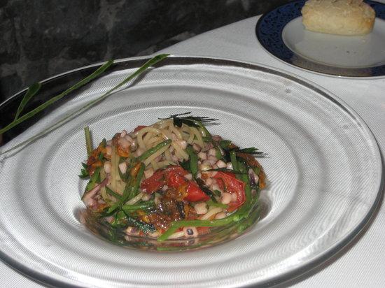 Il Faro di Capo D'Orso: Homemade fresh spaghetti with seafood, including sea urchin delicately mixed into the sauce.