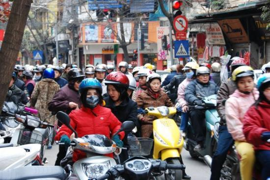 Hanoï, Vietnam : hundreds of bikers lining up at one of the street, not able to find out why since no one speaks