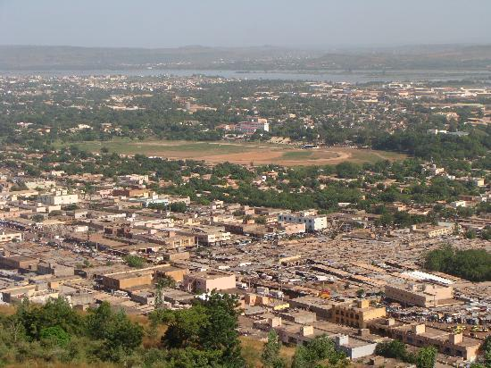 Azalai Grand Hotel: View of Bamako with covered market in foreground, hippodrome in centre and river Niger in distan