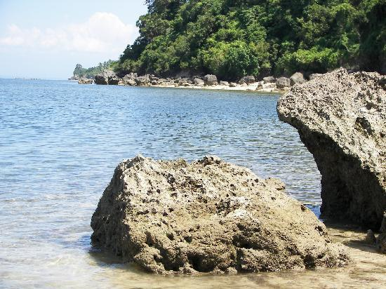Glan, Philippines: View of rock formation and distant beach