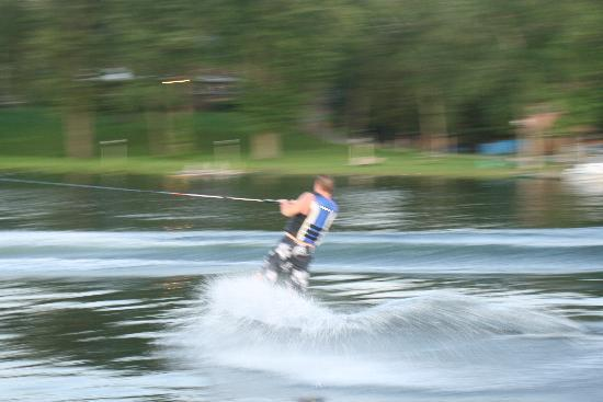 water skiing in front of the Lake House