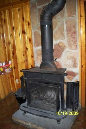 The fireplace inside the cabin
