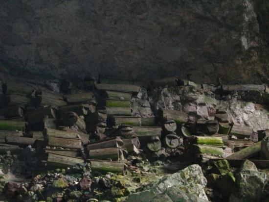 Sagada, Philippines: Coffin of the tribal people that was kept in the cave entrance. Those smaller ones are around 40