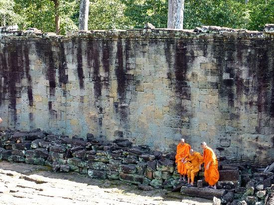 Siem Reap, Cambodia: Monks resting in their orange robes.