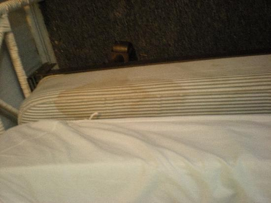 Catherine Hotel: Stain on the bed. They didn't even try and cover it