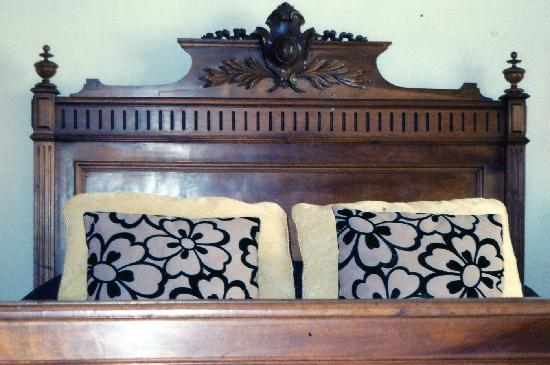 Coastal Fringes: Antique Carved Bed
