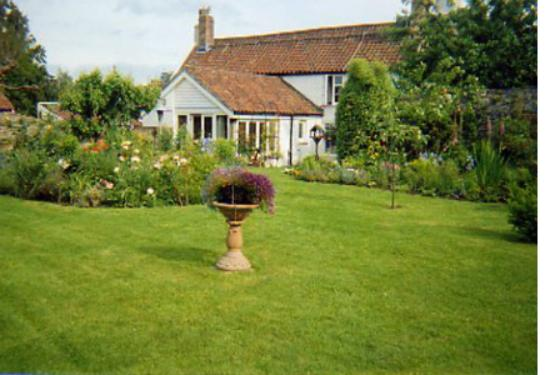 York Cottage: Our spacious garden is perfect to relax in or for your dogs to run around in.