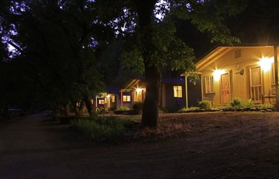 ‪‪Marble Mountain Ranch - Family Guest Ranch‬: standard cabins at night‬