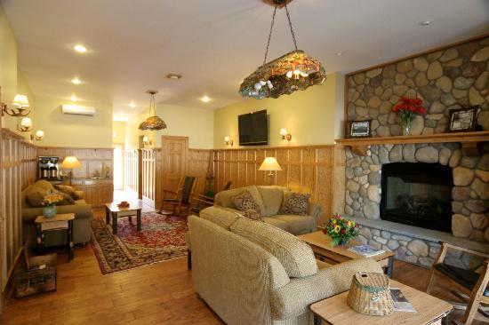 The Alpine Lodge: The Great Room- a common area with fireplace and large flat screen
