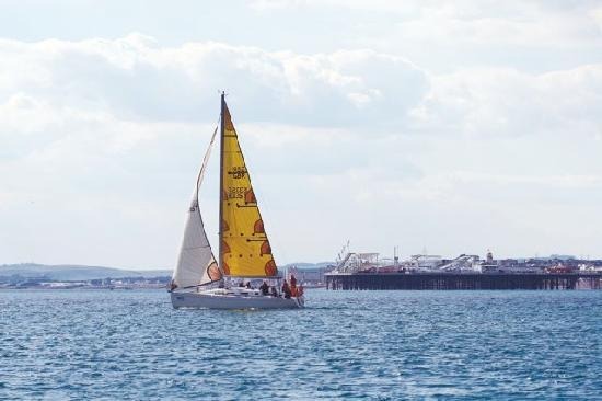 Lagoon Watersports - Brighton Marina: Yacht sailing by Brighton pier