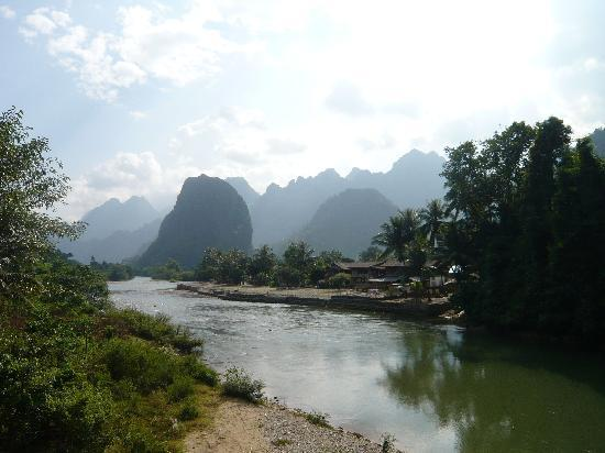 Hotel 39 s front picture of villa nam song vang vieng vang for Domon river guesthouse vang vieng