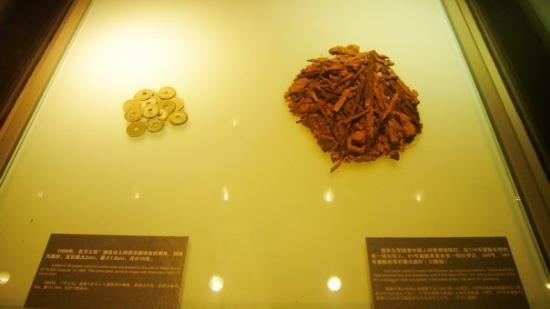 The Memorial of the Nanjing Massacre: Nanjing Massacre Memorial Hall Left: Coins found in the grave Right: Iron nails used to kill C