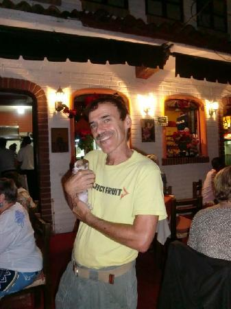 Cafe Bohemio: One of the owners, Sol shows off a guest's puppy