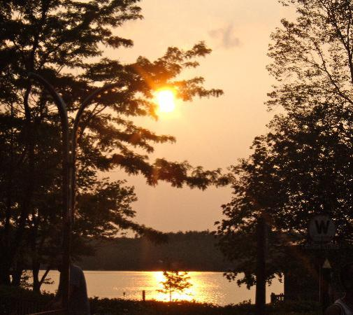 Salem, NH: Sunset by lake in park.