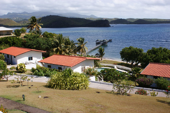 Coral Cove Cottages & Apartments: Cottages 5 and 4 (L to R) and the jetty