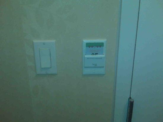 Hilton Garden Inn Detroit/Novi: To conserve energy you must put your room card in the switch slot to turn on the lights in the r