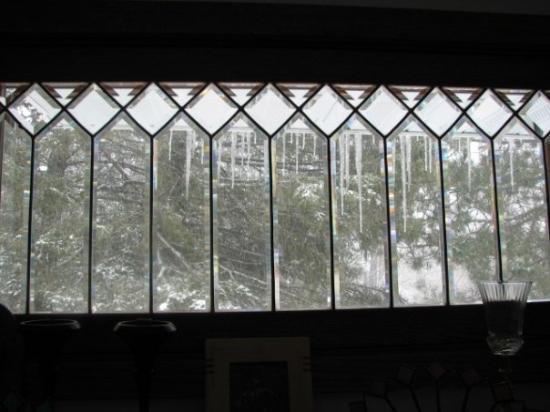 Embarrass, MN: Icicles thru antique windows