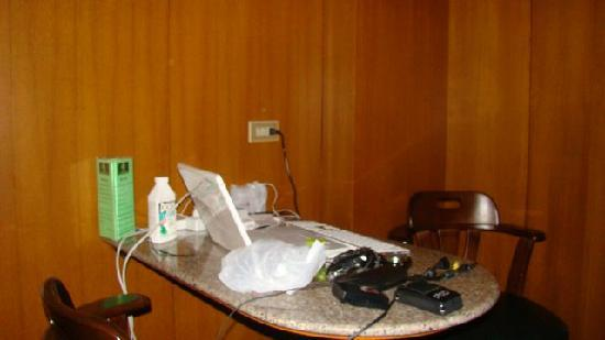 Dynasty Inn: My work area in room.
