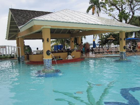 I love the swim up bar picture of sandals negril beach for Best vacations in december for couples