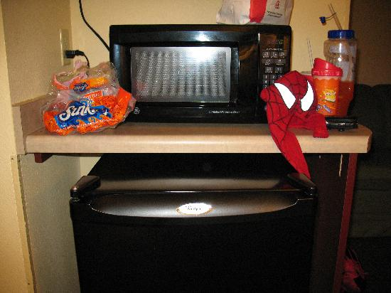 Comfort Suites: Microwave, Refrigerator (Coffee Maker not shown)