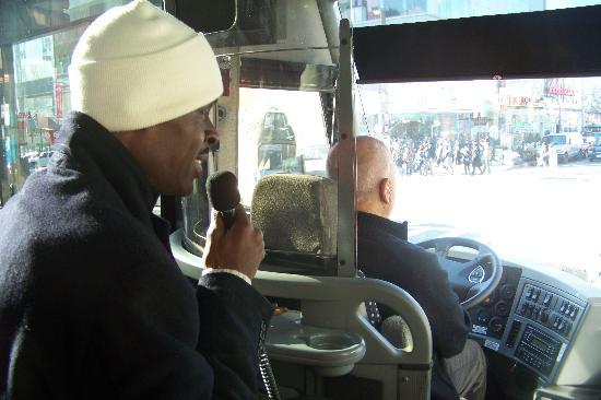 Harlem Heritage Tours: Tour guide on Bus showing us many sites